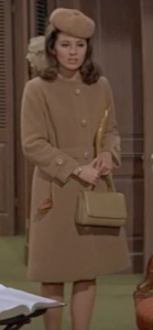 Who knew a completely camel outfit could look so chic? Here, Welles' beret, coat and purse rise above the Winter style hump.
