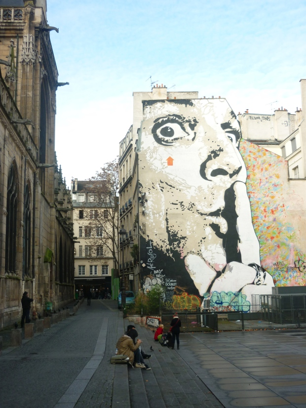 A massive graffiti image of Salvador Dalí adjacent to the Centre Pompidou.