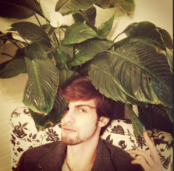 I just had to snag a photo sitting in one of the shop's chairs with a plant practically eating me!