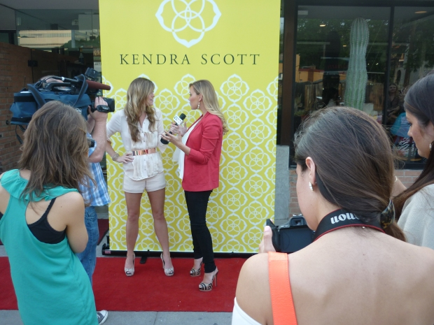 "Kendra Scott being interviewed by YNN before the TV premiere of ""Crowd Rules."""