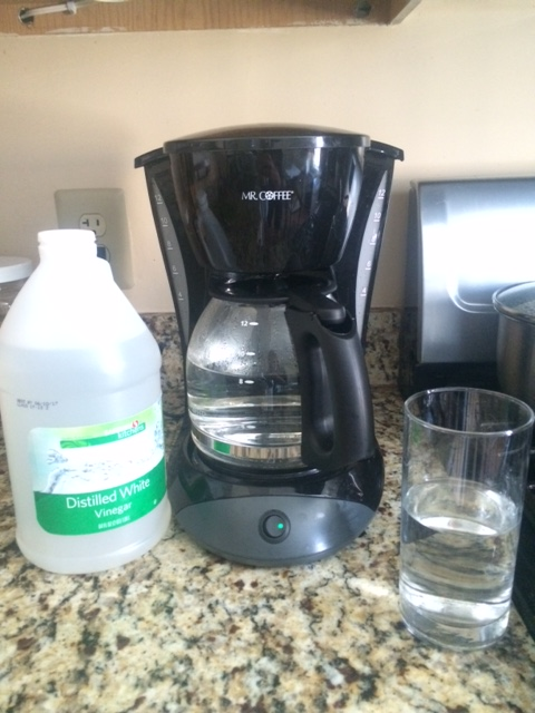 My new Mr. Coffee coffeemaker brewing the anti-chemical solution - vinegar and water.