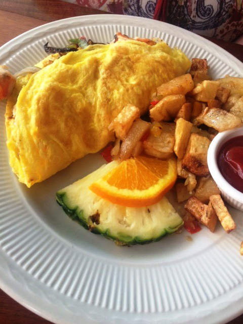 Omelette and tropical fruit